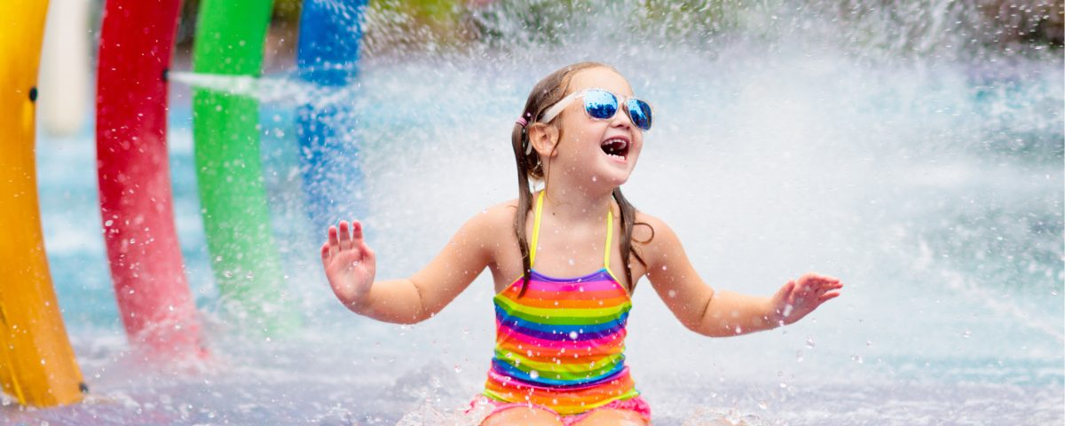 A little girl splashes at the largest Voertex Splashpad in North Carolina in Davie County at the Community Park